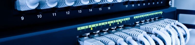 A networking photo showing Ethernet cables coming from a network switch